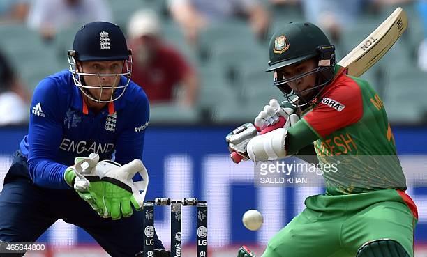Bangladesh batsman Mushfiqur Rahim plays a shot as England's wicket Jos Buttler looks on during the Pool A 2015 Cricket World Cup match between...