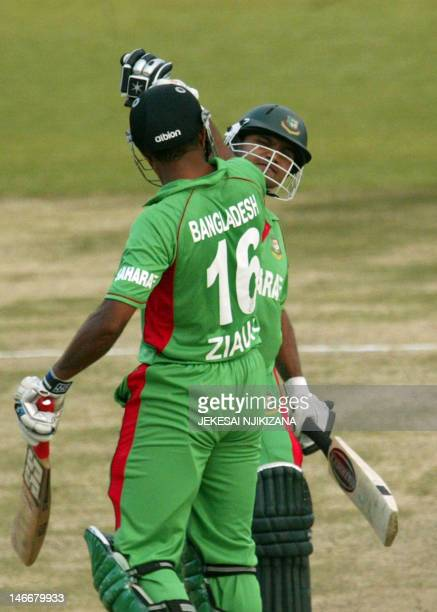 Bangladesh batsman Mushrafe Mortaza and Ziaur Rahman punch fists after winning during the second match between Bangladesh and South Africa in the...