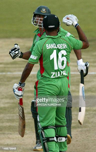 Bangladesh batsman Mushrafe Mortaza and Ziaur Rahman punch fists after winning against South Africa in the Twenty20 trinations tournament at the...