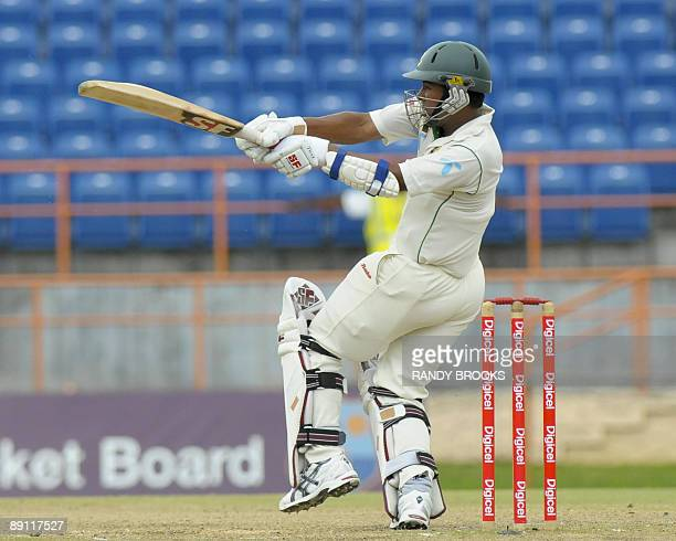 Bangladesh batsman Raqibul Hasan pulls West Indies bowler Tino Best for four runs on the fourth day of the second test match at Grenada National...