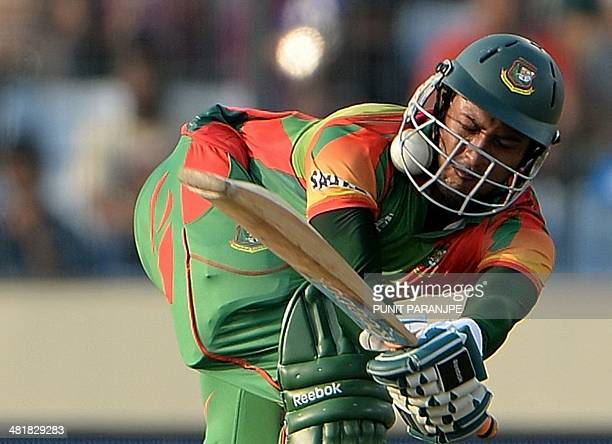 Bangladesh batsman Shakib Al Hasan attempts to play a shot as the ball hits his helmet during the ICC World Twenty20 tournament cricket match between...