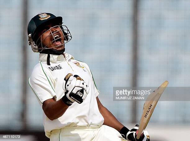 Bangladesh batsman Shamsur Rahman reacts after scoring a century during the third day of the second Test match between Bangladesh and Sri Lanka at...