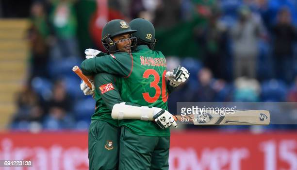 Bangladesh batsmen Shakib Al Hasan and Mohammad Mahmudullah celebrate after Hasan had reached his century during their partnership during the ICC...