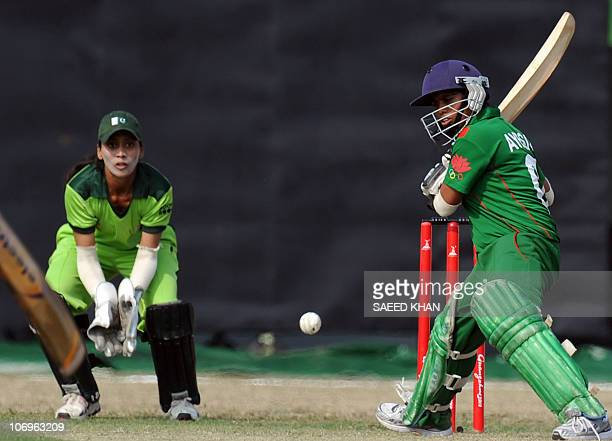 Bangladesh batswoman Ayesha Akter plays a shot as Pakistan wicketkeeper Fatima Naqvi eyes the ball during their women's limited overs final at the...
