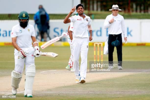 Bangladesh bowler Mustafizur Rahman celebrates the dismissal of South African batsman Hashim Amla during the fourth day of the first Test cricket...