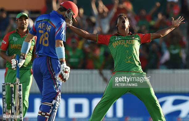 Bangladesh bowler Rubel Hossain celebrates taking the wicket of Afsar Zazai of Afghanistan during the Pool A 2015 Cricket World Cup match between...