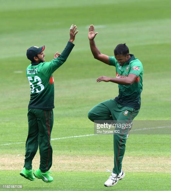 Bangladesh bowler Rubel Hossain celebrates with Mehidy Hasan Miraz after taking the wicket of Rohit Sharma during the ICC Cricket World Cup 2019 Warm...