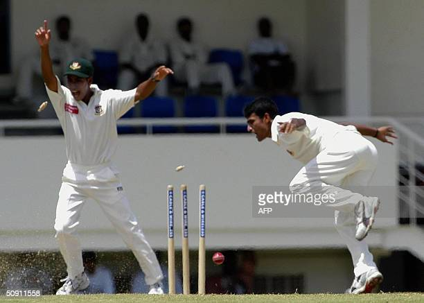 Bangladesh bowler Tareq Khan runs out West Indies opening batsman Devon Smith for 0 as Mohammed Ashraful celebrates on the third day of the first...