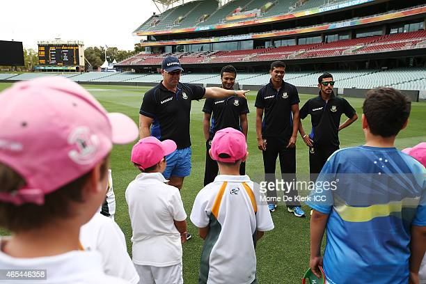 Bangladesh bowling coach Heath Streak introduces Bangladesh cricket players to kids from the Woodville Rechabite Cricket Club during the ICC Charity...