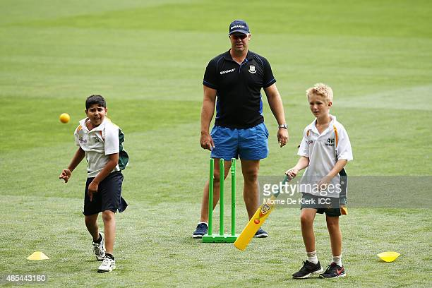 Bangladesh bowling coach Heath Streak looks on as kids from the Woodville Rechabite Cricket Club bat and bowl during the ICC Charity Coaching Clinic...