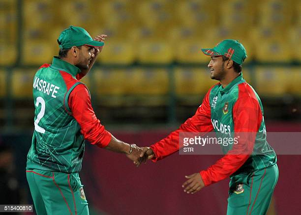 Bangladesh captain Masfrafe Bin Mortaza and teammate Shakib Al Hasan shake hands after winning the qualifying match for the World T20 cricket...