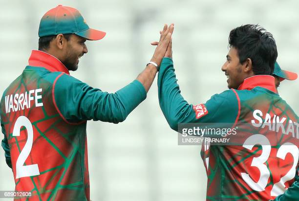 Bangladesh captain Mashrafe Mortaza and teammate Mosaddek Hossain celebrate the wicket of Pakistan batsman Sarfraz Ahmad off Saikat's bowling during...