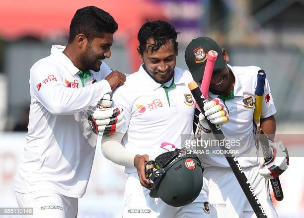 Bangladesh captain Mushfiqur Rahim and teammates celebrate their victory over Sri Lanka by four wickets on the fifth and final day of the second and...