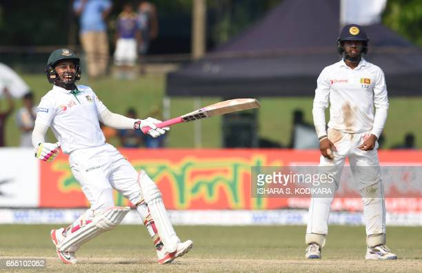 Bangladesh captain Mushfiqur Rahim reacts as he celebrates his teams victory over Sri Lanka by four wickets on the fifth and final day of the second...