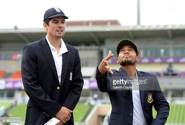 Bangladesh captain Mushfiqur Rahim tosses the coin alongside England captain Alastair Cook ahead of the first day of the 2nd Test match between...