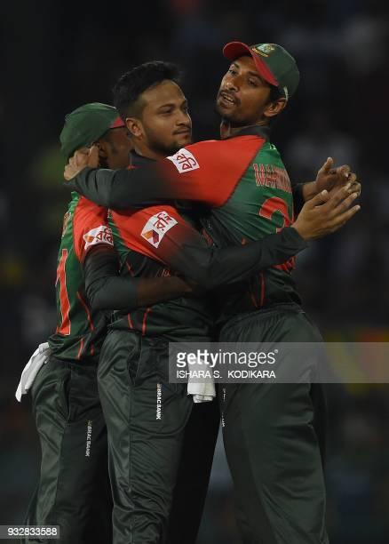 Bangladesh captain Shakib Al Hasan celebrates with teammate Mohammad Mahmudulla after dismissing Sri Lanka's Danushka Gunathilaka during the sixth...