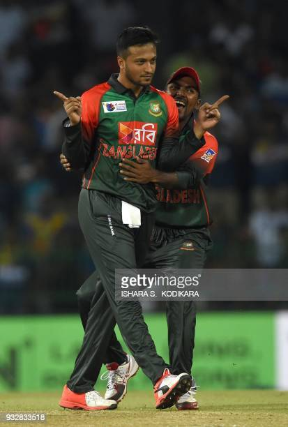 Bangladesh captain Shakib Al Hasan celebrates with teammate Nazmul Islam after dismissing Sri Lanka's Danushka Gunathilaka during the sixth Twenty20...