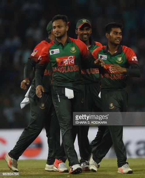Bangladesh captain Shakib Al Hasan celebrates with teammates after dismissing Sri Lanka's Danushka Gunathilaka during the sixth Twenty20...