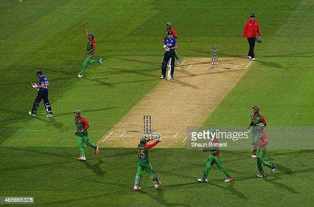 Bangladesh celebrate after taking the wicket of James Taylor of England during the 2015 ICC Cricket World Cup match between England and Bangladesh at...