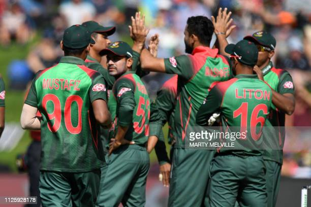 Bangladesh celebrate New Zealand's Colin Munro being caught with LBW during the 3rd ODI cricket match between New Zealand and Bangladesh at...