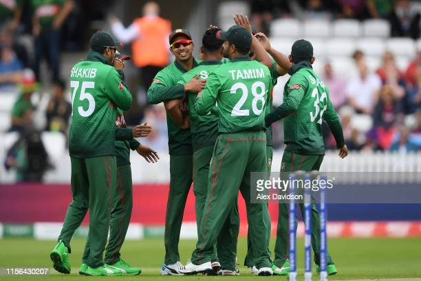 Bangladesh celebrate the wicket of Chris Gayle of West Indies during the Group Stage match of the ICC Cricket World Cup 2019 between West Indies and...