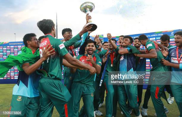 Bangladesh celebrate with the trophy after winning the ICC U19 Cricket World Cup Super League Final match between India and Bangladesh at JB Marks...