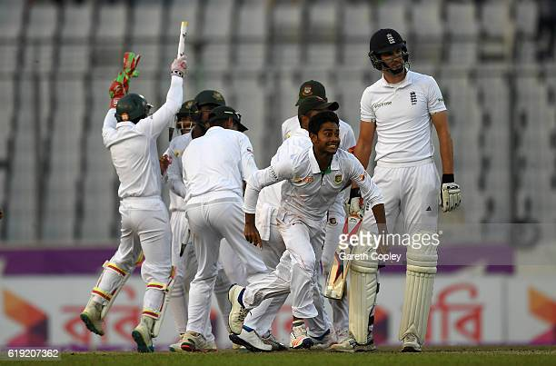 Bangladesh celebrates taking the final wicket of Steven Finn to win the second Test match between Bangladesh and England at ShereBangla National...
