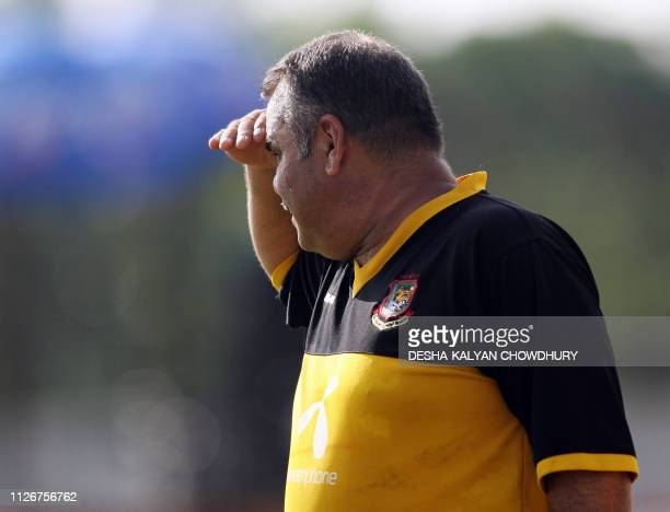Bangladesh coach Dev Whatmore gestures during a practice at the Ruhul Amin stadium in Chittagong 19 May 2007 Bad weather delayed the second day's...