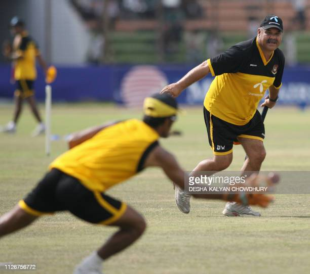 Bangladesh coach Dev Whatmore throws a ball to Bangladeshi players during a practice session at the Ruhul Amin stadium in Chittagong 19 May 2007 Play...