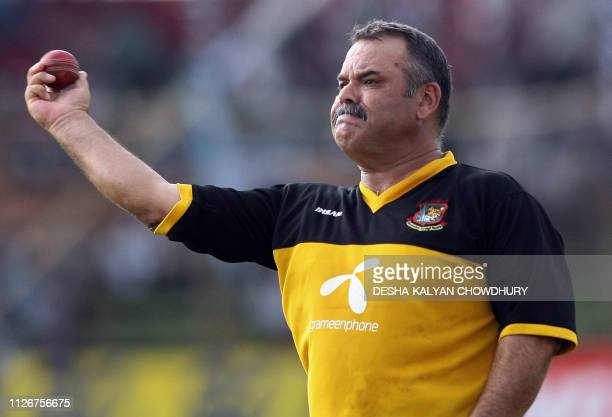 Bangladesh coach Dev Whatmore throws a cricket ball during a practice at the Ruhul Amin stadium in Chittagong 19 May 2007 Bad weather delayed the...