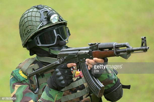 Bangladesh commandos participate in a mock war game at the ShereBangla National Stadium in Dhaka on October 6 a day before the first match between...