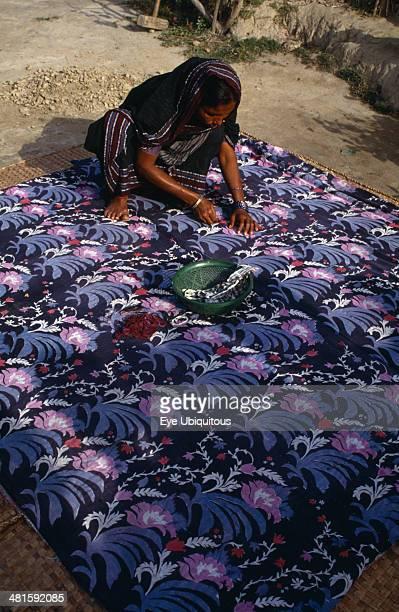 Bangladesh Crafts Bengali woman making traditional quilt