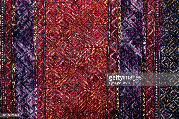 Bangladesh Crafts Textiles Detail of red and purple woven murang pinon or loin cloth