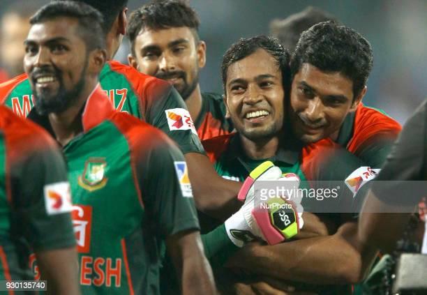 Bangladesh cricket captain Mahmudullah Riyad hugs Mushfiqur Rahim after winning the 3rd T20 cricket match of NIDAHAS Trophy between Sri Lanka and...