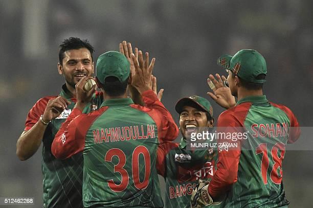 Bangladesh cricket captain Mashrafe Bin Mortaza celebrates with teammates after the dismissal of the United Arab Emirates cricketer Shaiman Anwar...