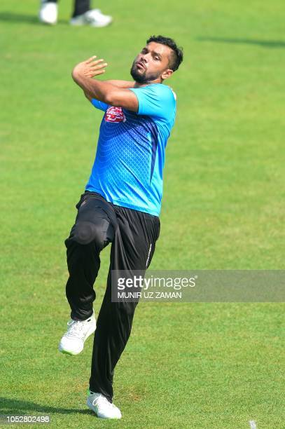 Bangladesh cricket captain Mashrafe Bin Mortaza delivers a ball during a training session ahead of the second one day international cricket match...
