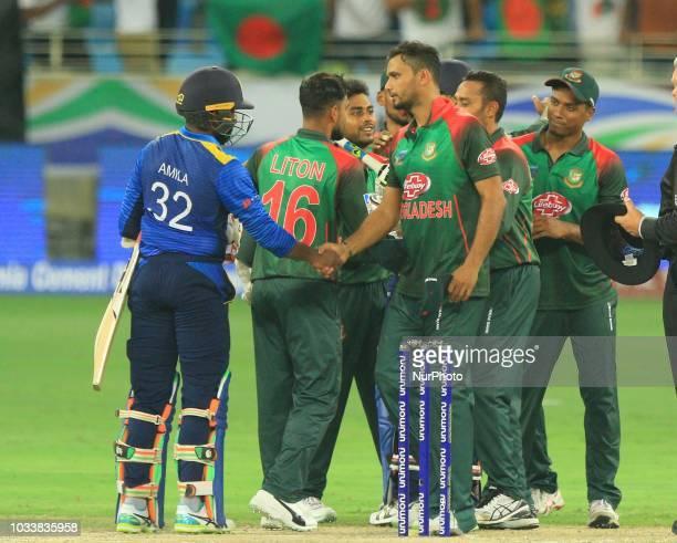 Bangladesh cricket captain Mashrafe Mortaza and his team mates celebrate the win against the Sri Lankan cricket team during the first cricket match...