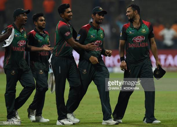 Bangladesh cricket captain Mashrafe Mortaza and his teammates celebrate after Bangladesh won by 37 runs during the one day international Asia Cup...