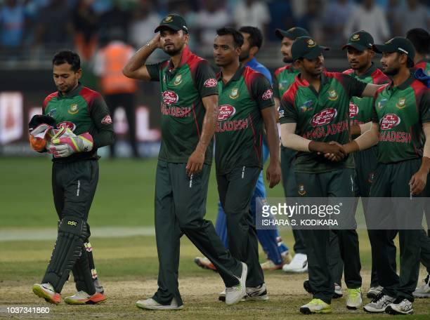 Bangladesh cricket captain Mashrafe Mortaza and his teammates leave the field after India won by 7 wickets during the one day international Asia Cup...