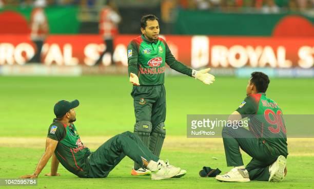 Bangladesh cricket captain Mashrafe Mortaza and Mushfiqur Rahim discuss during the final cricket match of Asia Cup 2018 between India and Bangladesh...