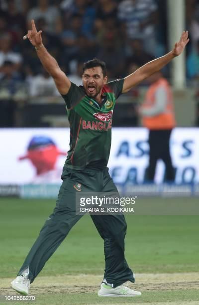 Bangladesh cricket captain Mashrafe Mortaza appeals for an unsuccessful leg before wicket decision against unseen Indian batsman Kedar Jadhav during...