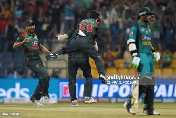 Bangladesh cricket captain Mashrafe Mortaza celebrates with his teammates after he dismissed Pakistan batsman Babar Azam during the one day...