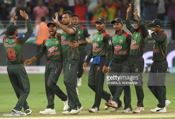 Bangladesh Cricket captain Mashrafe Mortaza celebrates with teammates after he dismissed Sri Lankan batsman Dhananjaya de Silva during the one day...