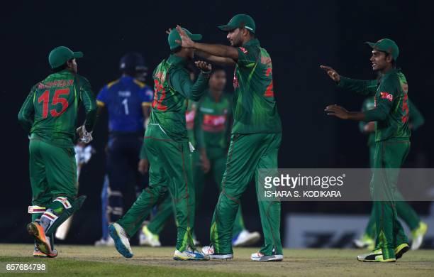Bangladesh cricket captain Mashrafe Mortaza celebrates with teammates after Bangladesh defeated Sri Lanka by 90 runs in the first one day...
