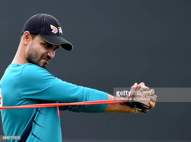 TOPSHOT Bangladesh cricket captain Mashrafe Mortaza stretches during a practice session at The Rangiri Dambulla International Cricket Stadium in...