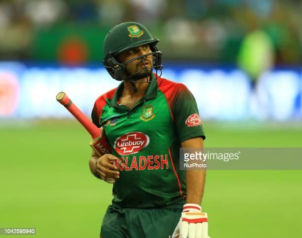 Bangladesh cricket captain Mashrafe Mortaza walks back following his dismissal during the final cricket match of Asia Cup 2018 between India and...
