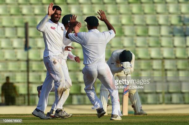 Bangladesh cricket captain Mohammad Mahmudullah celebrates with his teammates after the dismissal of the Zimbabwe cricketer Sean Williams during the...