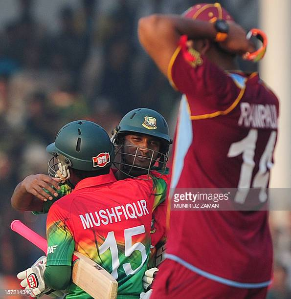 Bangladesh cricket captain Mushfiqur Rahim hugs with his teammate Naeem Islam after winning the first one day international cricket match between...