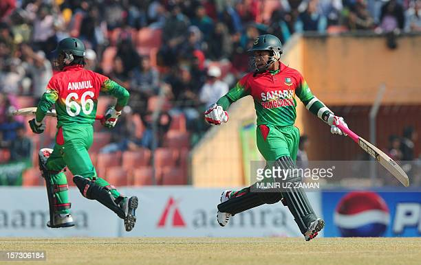 Bangladesh cricket captain Mushfiqur Rahim run between the wickets with his teammate Anamul Haque during the second one day international cricket...