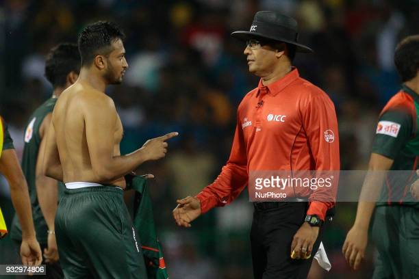 Bangladesh cricket captain Shakib Al Hasan is seen in a conversation with the on field umpire Ruchira Palliyaguruge during the 6th T20 cricket match...
